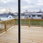 Apex Construction Iowa City IA New Home 110 Cherry Lane Riverside Iowa backyard deck